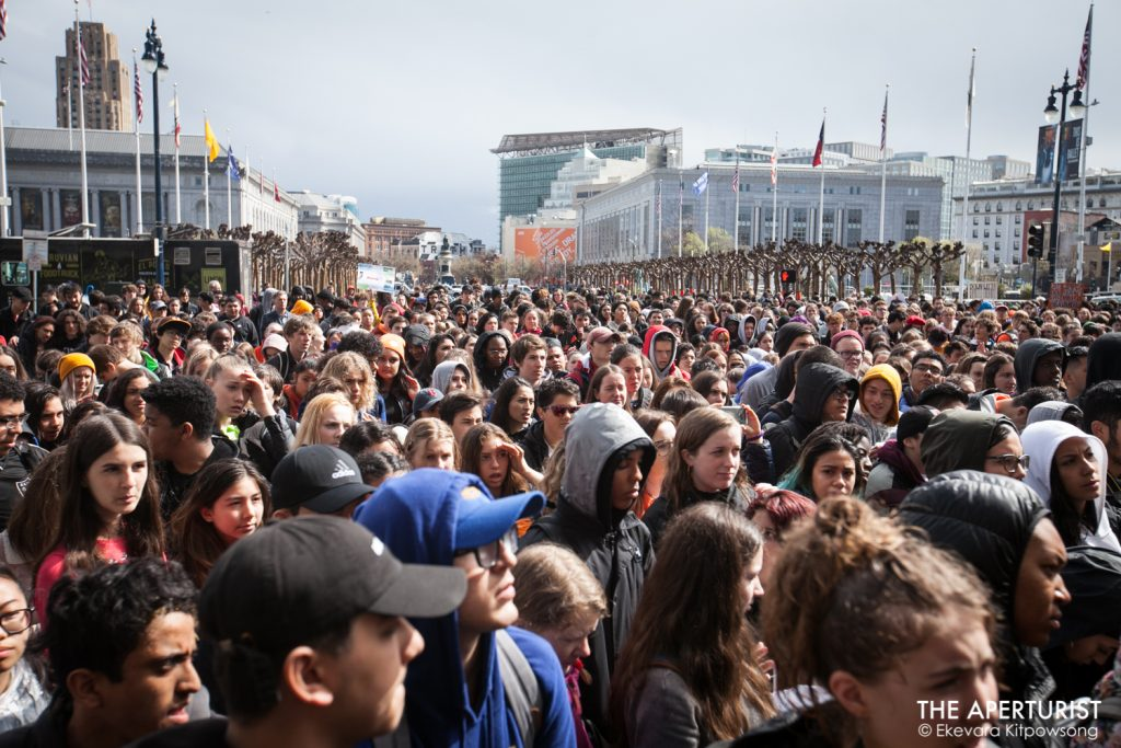 Huge crowd of students gathers in front of San Francisco City Hall on Wednesday, March 14, 2018 as part of a nationwide school walkout to protest against gun violence on the one-month anniversary of the Parkland school shooting in Florida that a gunman killed 17 people. (Photo by Ekevara Kitpowsong)
