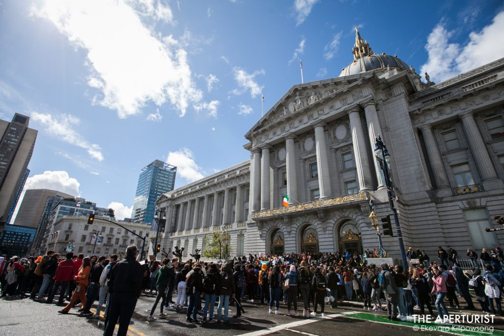 Huge crowd of students gathers in front of San Francisco City Hall on Wednesday, March 14, 2018, as part of a nationwide school walkout to protest against gun violence on the one-month anniversary of the high school shooting that a gunman killed 17 people at Marjory Stoneman Douglas High School in Parkland, Florida. (Photo by Ekevara Kitpowsong)