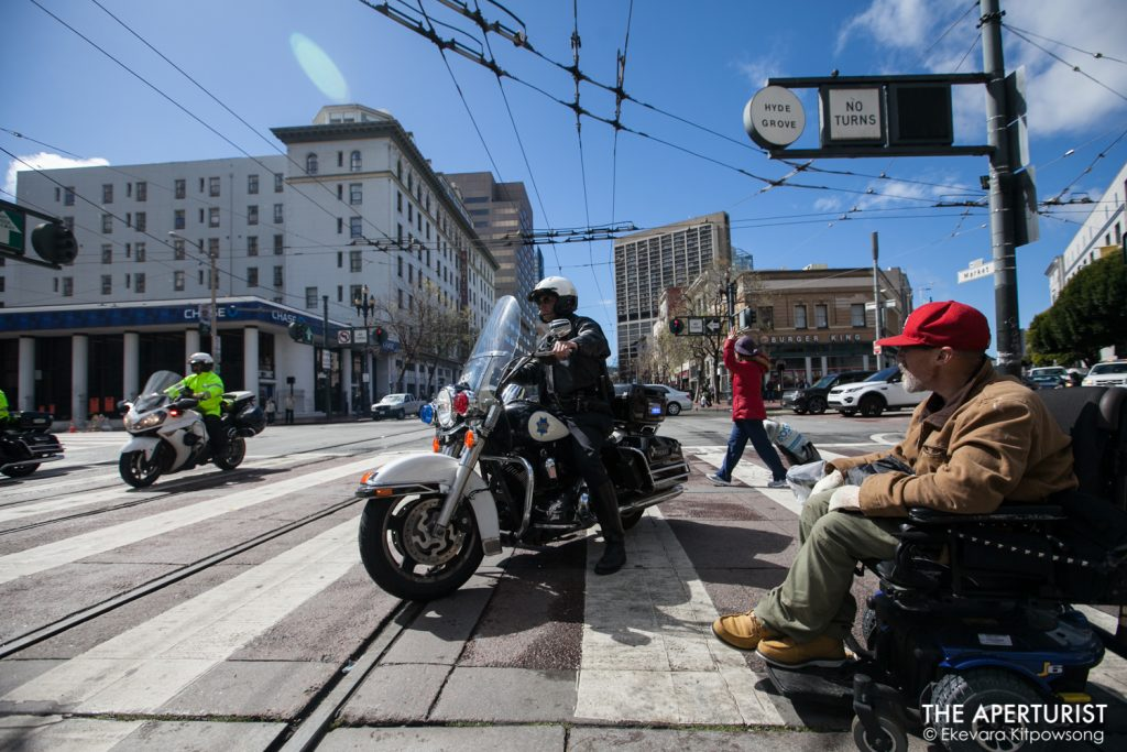 Police officers block Market Street as protesters march from San Francisco City Hall to Embarcadero on Wednesday, March 14, 2018 as part of a nationwide school walkout to protest against gun violence on the one-month anniversary of the Parkland school shooting in Florida that a gunman killed 17 people. (Photo by Ekevara Kitpowsong)