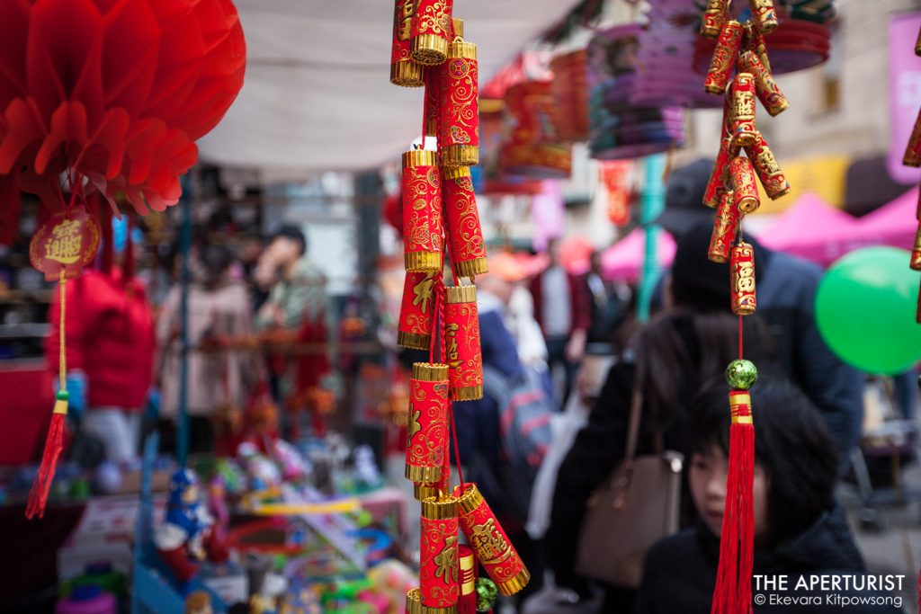 The ornaments can be seen hanging at the vendor in the festival before San Francisco's Chinese New Year Parade on Saturday, Feb. 23, 2019. (Photo by Ekevara Kitpowsong/Current SF)