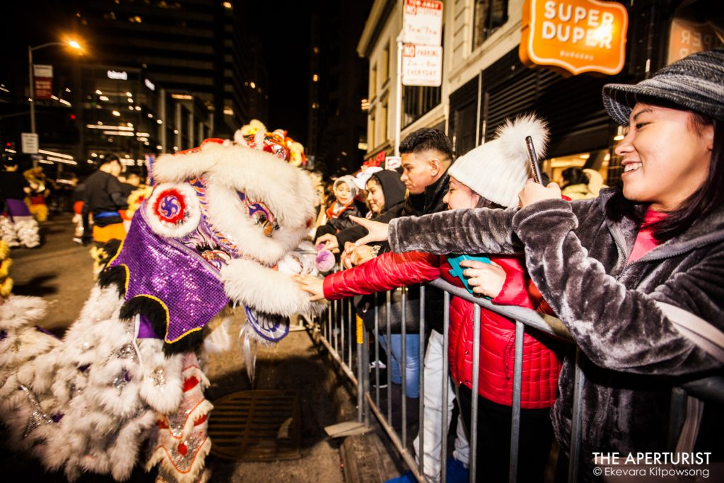 Parade-goers reach to touch a lion during San Francisco's Chinese New Year Parade on Saturday, Feb. 23, 2019. (Photo by Ekevara Kitpowsong/Current SF)