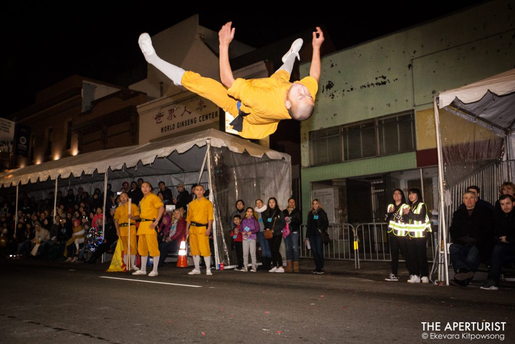 A performer jumps in the air in San Francisco's Chinese New Year Parade on Saturday, Feb. 23, 2019. (Photo by Ekevara Kitpowsong/Current SF)