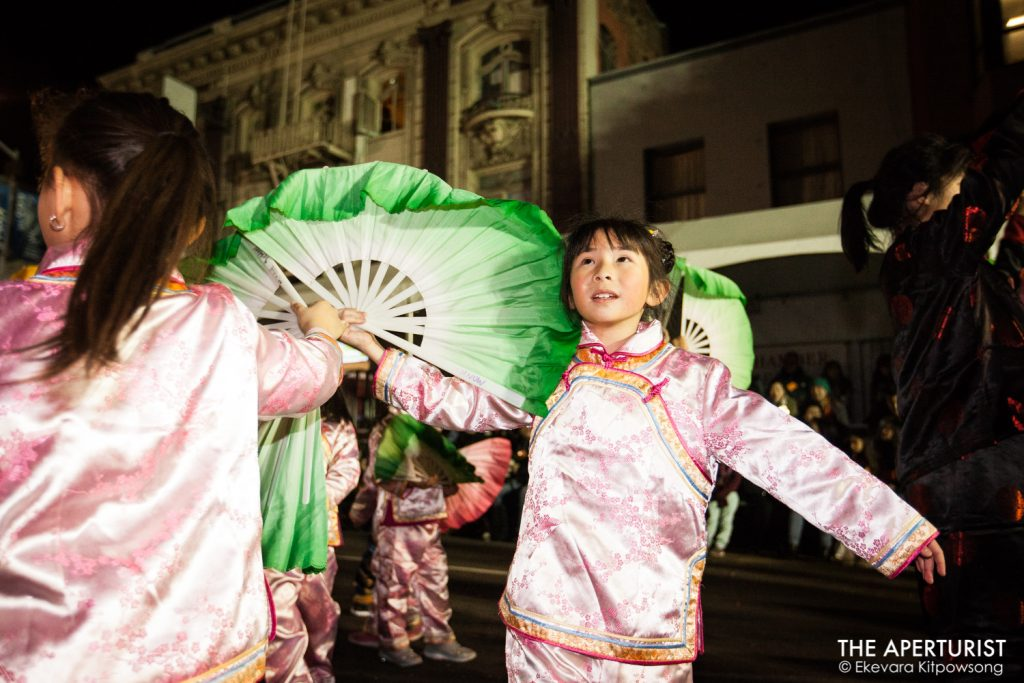 Parade participants perform with Chinese traditional fans in San Francisco's Chinese New Year Parade on Saturday, Feb. 23, 2019. (Photo by Ekevara Kitpowsong/Current SF)