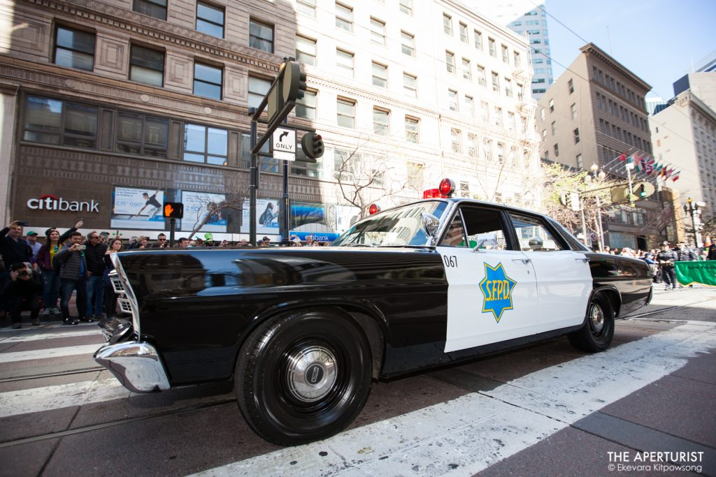 San Francisco police car rolls down Market Street during the 168th annual San Francisco St. Patrick's Day Parade on Saturday, March 16, 2019. (Photo by Ekevara Kitpowsong/Current SF)