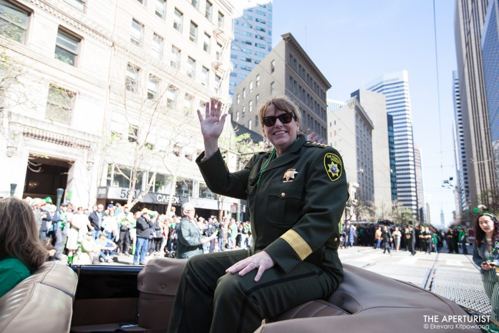San Francisco Sheriff Vicki Hennessy smiles and waves to the crowd on Market Street during the 168th annual San Francisco St. Patrick's Day Parade on Saturday, March 16, 2019. (Photo by Ekevara Kitpowsong/Current SF)