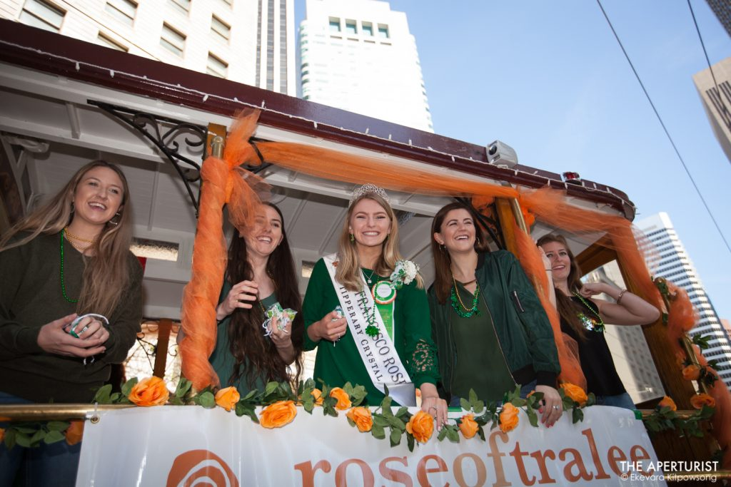 Participants on the cable car smile to the crowd during the 168th annual San Francisco St. Patrick's Day Parade on Saturday, March 16, 2019, in San Francisco, Calif. (Photo by Ekevara Kitpowsong/Current SF)