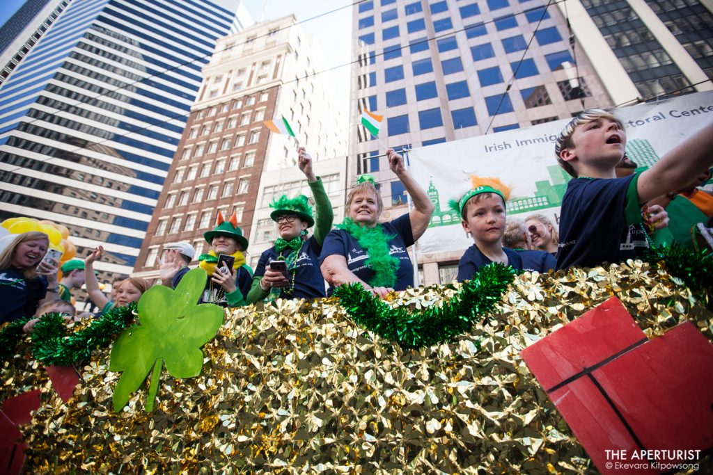 Participants on the float smile and wave to the crowd during the 168th annual San Francisco St. Patrick's Day Parade on Saturday, March 16, 2019, in San Francisco, Calif. (Photo by Ekevara Kitpowsong/Current SF)