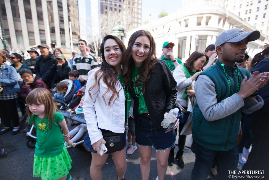 Parade watchers enjoy watching the 168th annual San Francisco St. Patrick's Day Parade on Market Street in San Francisco on Saturday, March 16, 2019. (Photo by Ekevara Kitpowsong/Current SF)