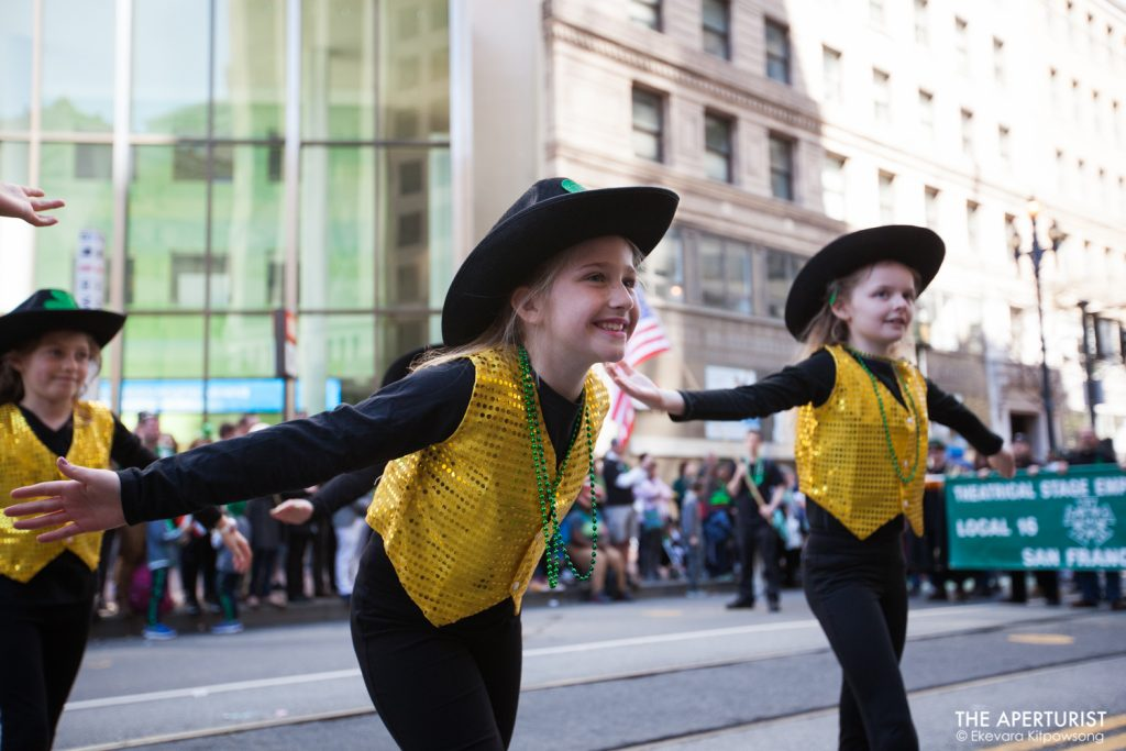 Participants perform on Market Street during the 168th annual San Francisco St. Patrick's Day Parade on Saturday, March 16, 2019, in San Francisco, Calif. (Photo by Ekevara Kitpowsong/Current SF)