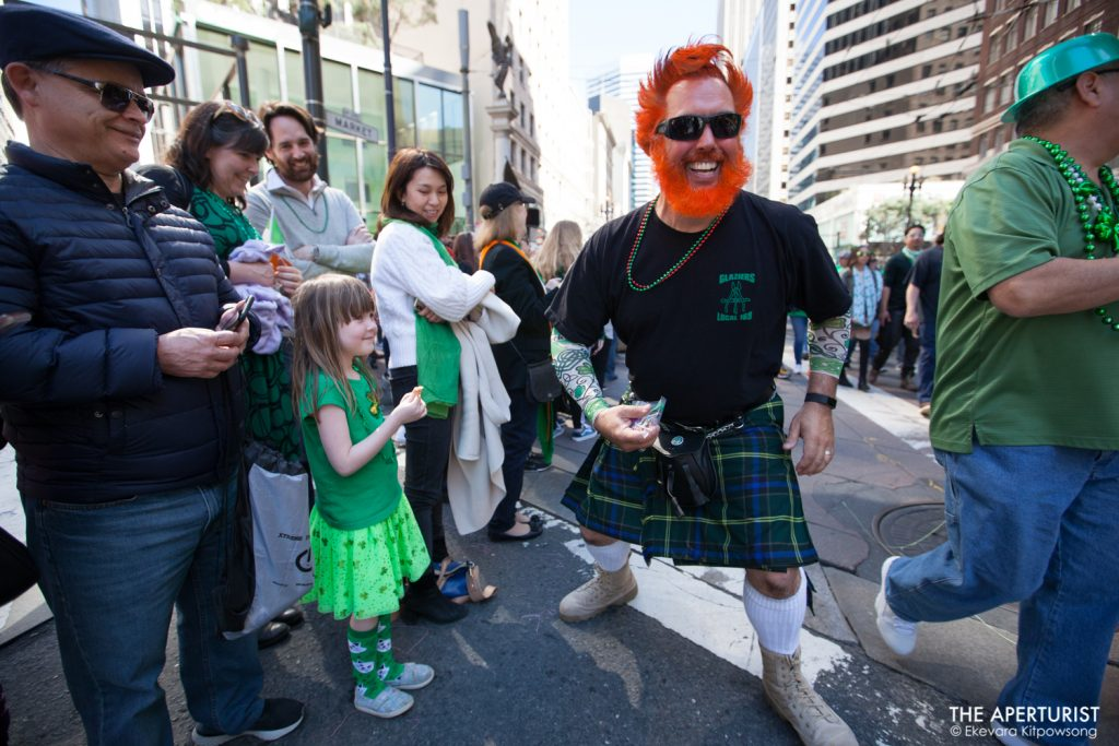 A participant in costume smiles and gives candy to a girl during the 168th annual San Francisco St. Patrick's Day Parade on Saturday, March 16, 2019, in San Francisco, Calif. (Photo by Ekevara Kitpowsong/Current SF)