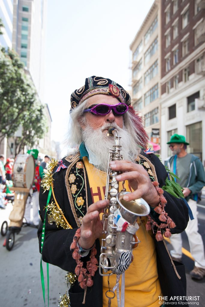 A participant plays a musical instrument during the 168th annual San Francisco St. Patrick's Day Parade on Saturday, March 16, 2019, in San Francisco, Calif. (Photo by Ekevara Kitpowsong/Current SF)