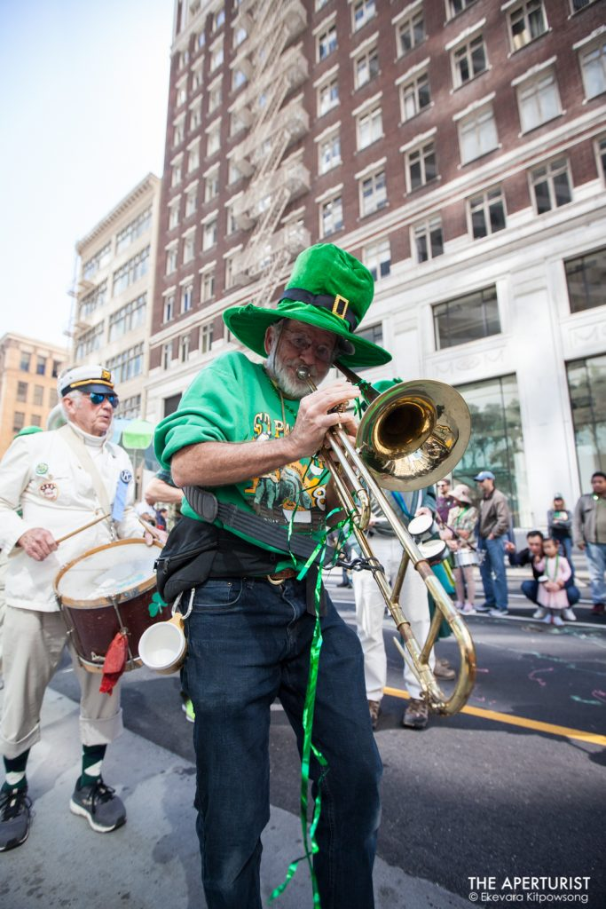 A participant plays a musical instrument during the St. Patrick's Day Parade on Saturday, March 16, 2019, in San Francisco, Calif. (Photo by Ekevara Kitpowsong/Current SF)