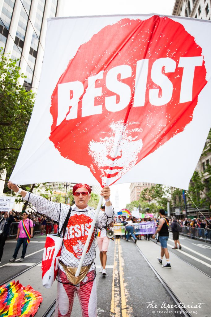 "A parade participant holds a large ""RESIST"" banner as he walks down Market Street during the San Francisco Pride Parade in San Francisco on Sunday, June 30, 2019. (Photo by Ekevara Kitpowsong/Current SF)"