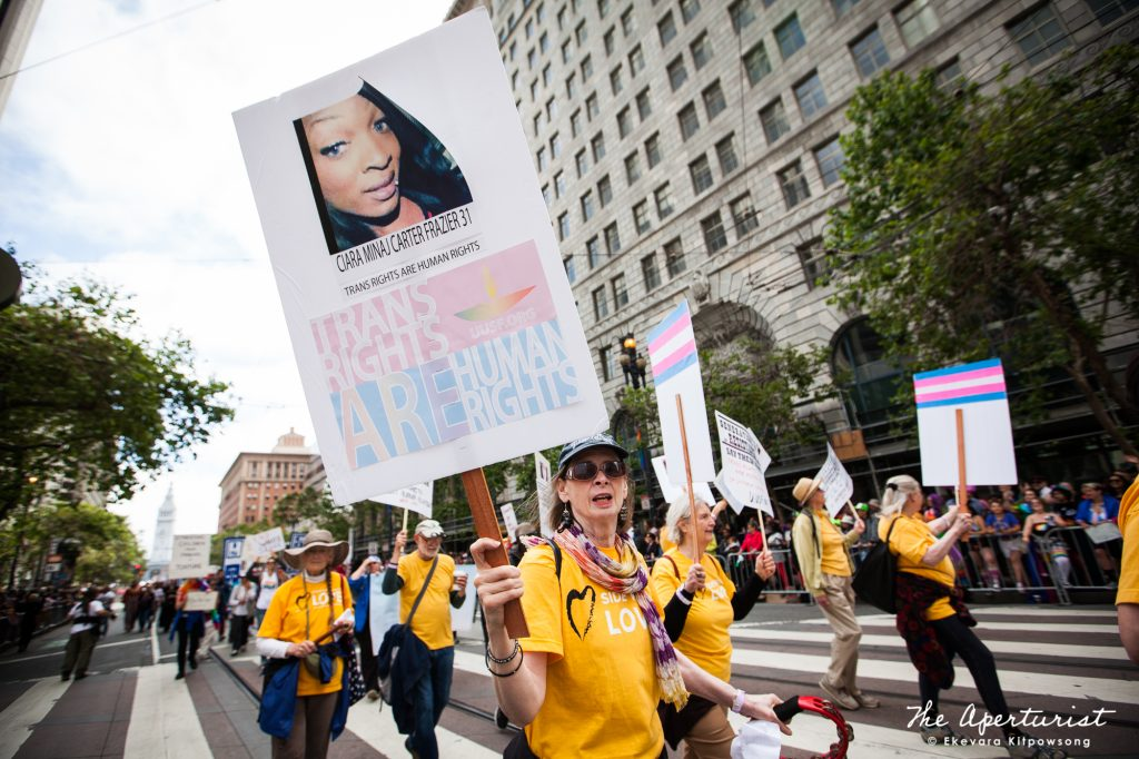 Parade participants hold banners at the San Francisco Pride Parade on Market Street in San Francisco on Sunday, June 30, 2019. (Photo by Ekevara Kitpowsong/Current SF)