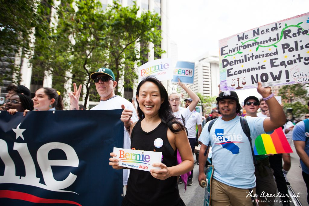 Former San Francisco Supervisor and Bay Area Director for Bernie Sanders 2020 Jane Kim and Bernie Sanders supporters take part in the San Francisco Pride Parade on Market Street in San Francisco on Sunday, June 30, 2019. (Photo by Ekevara Kitpowsong/Current SF)