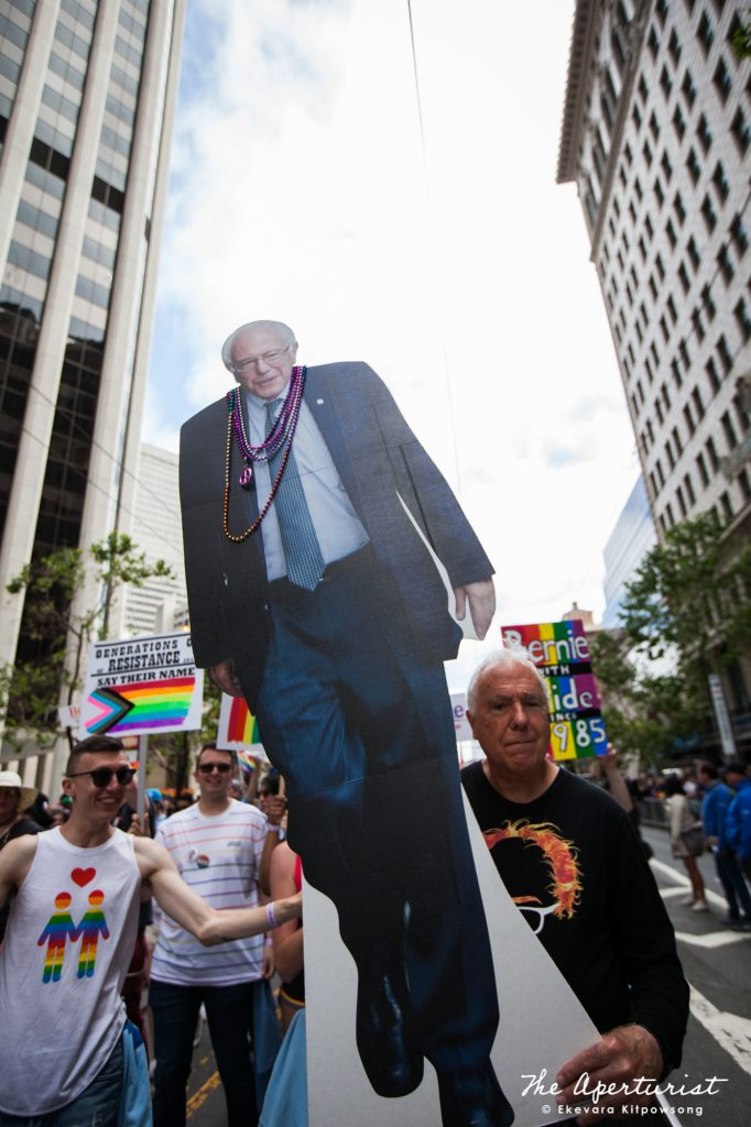 Parade participant holds a large cardboard cutout of U.S. Senator Bernie Sanders of Vermont and a candidate for President of the United States, during the San Francisco Pride Parade on Market Street in San Francisco on June 30, 2019. (Photo by Ekevara Kitpowsong/Current SF)