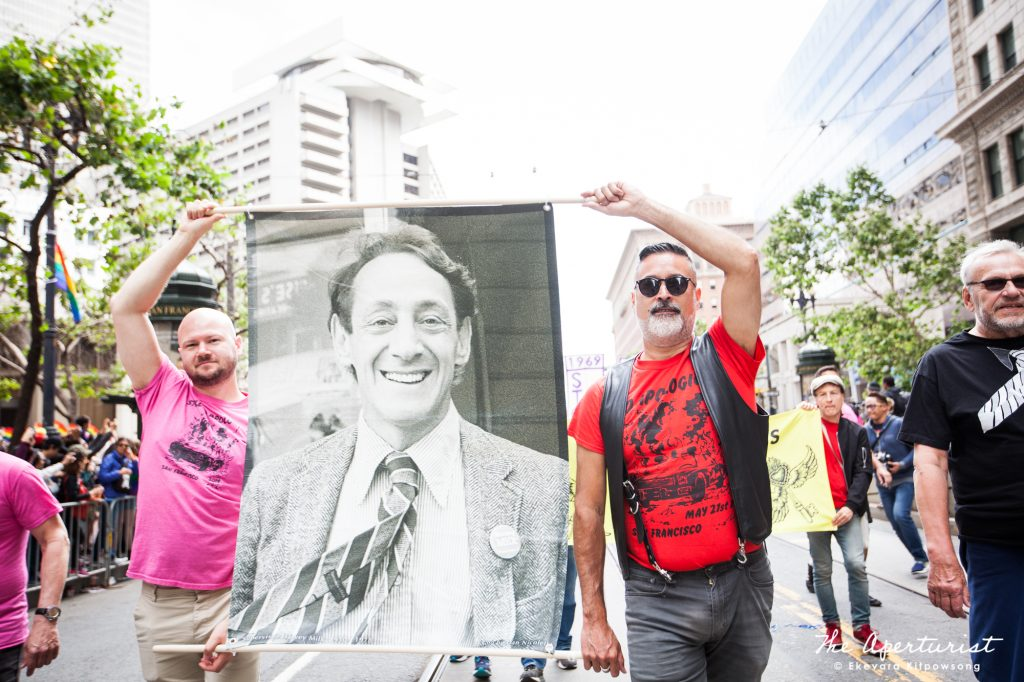 Parade participants carry a large banner, a photo of Harvey Milk, a civil and human rights leader and the first openly gay elected officials in the United States, at the San Francisco Pride Parade on Market Street in San Francisco on Sunday, June 30, 2019. (Photo by Ekevara Kitpowsong/Current SF)