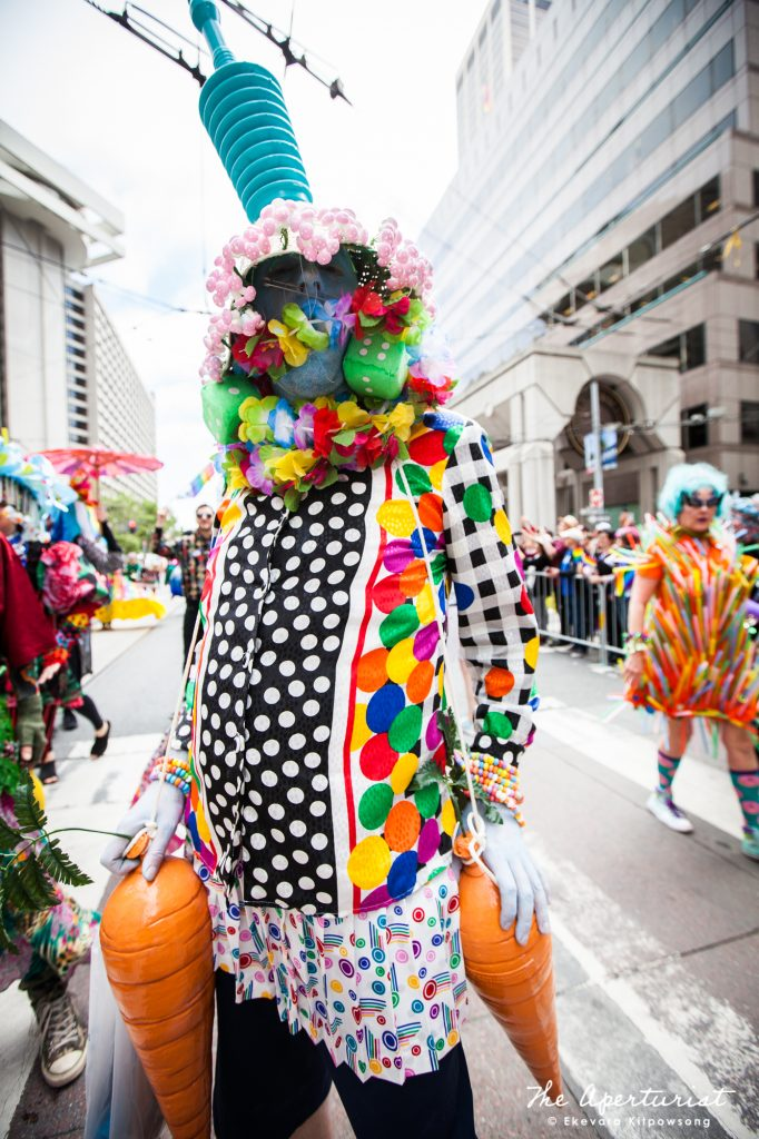 A parade participant from Verasphere in a colorful costume takes part in the San Francisco Pride Parade on Market Street in San Francisco on Sunday, June 30, 2019. (Photo by Ekevara Kitpowsong/Current SF)