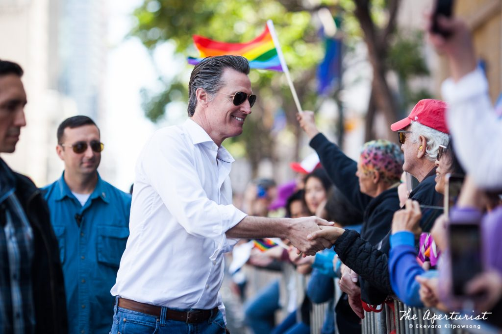 The 40th Governor of California and the former San Francisco mayor Gavin Newsom shakes hands with people in the crowd during the San Francisco Pride Parade on Sunday, June 30, 2019, in San Francisco, Calif. (Photo by Ekevara Kitpowsong/Current SF)