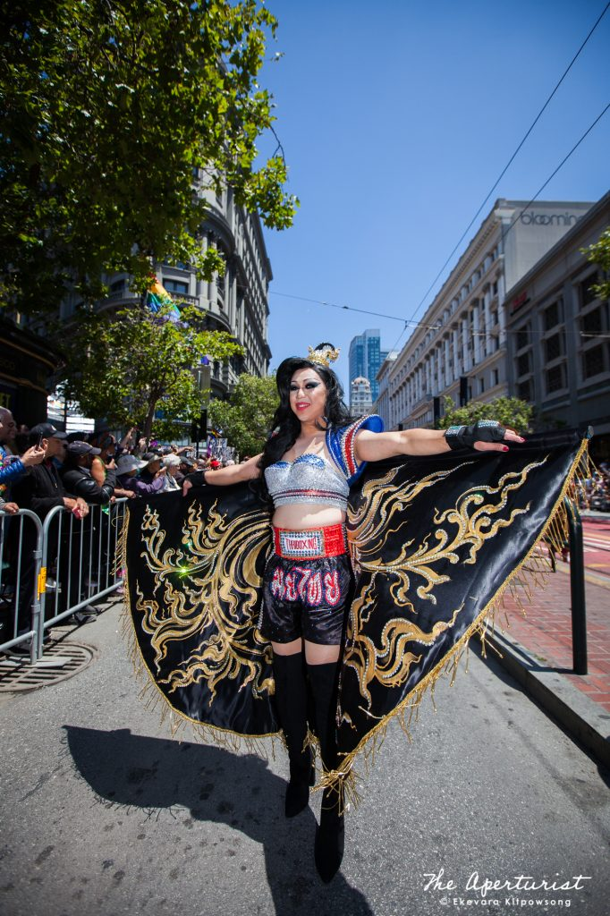 "A parade participant from Farmhouse Kitchen Thai Cuisine wears a ""Muay Thai"" a Thai boxing costume, in the ""Amazing Thailand"" theme, which features the most famous Thai food, national Thai costumes and icons of Thailand, at the San Francisco Pride Parade on Market Street in San Francisco on Sunday, June 30, 2019. (Photo by Ekevara Kitpowsong/Current SF)"