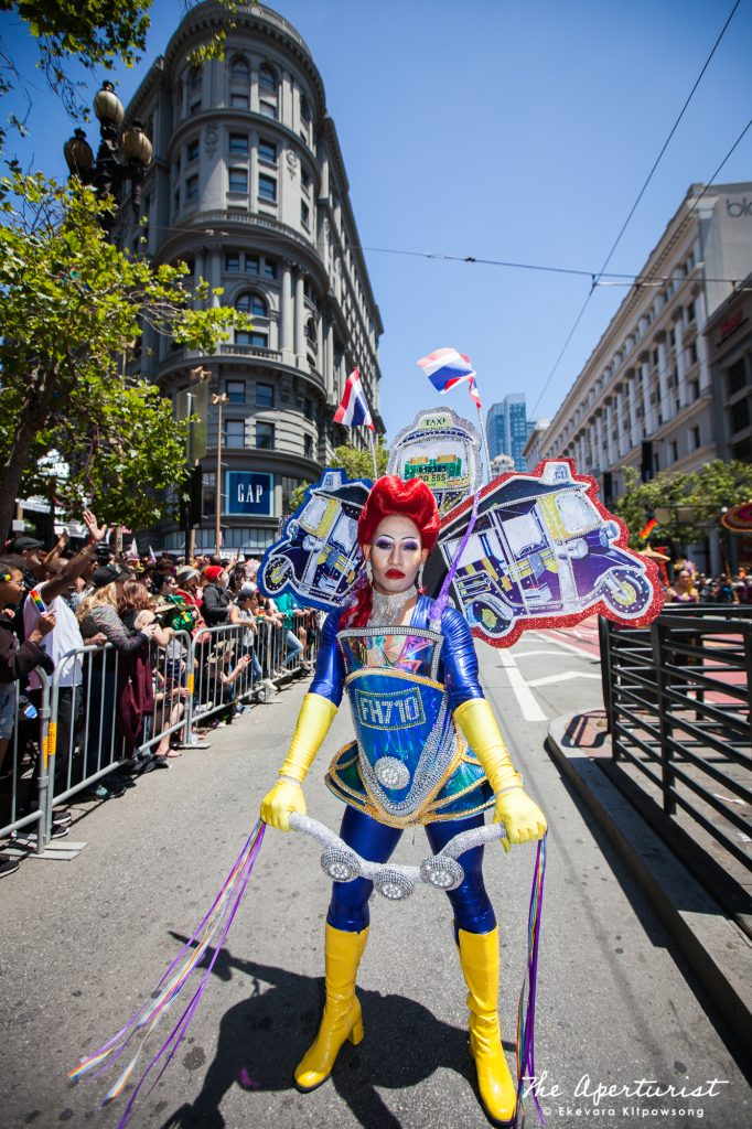 "A parade participant from Farmhouse Kitchen Thai Cuisine wears ""Tuk Tuk"" costume, a three-wheeled taxi, in the ""Amazing Thailand"" theme, which features the most famous Thai food and icons of Thailand, at the 49th annual San Francisco Pride Parade on Market Street in San Francisco on Sunday, June 30, 2019. (Photo by Ekevara Kitpowsong/Current SF)"