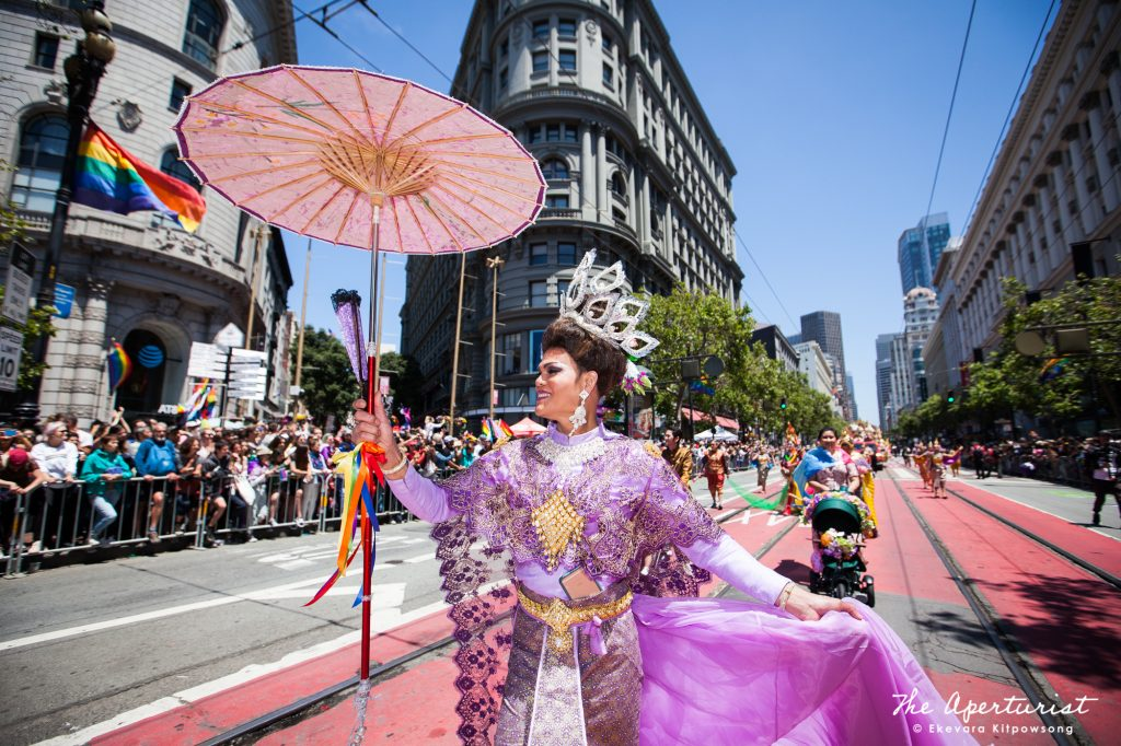 "A parade participant from Farmhouse Kitchen Thai Cuisine wears a Thai traditional costume from the historical period, in the ""Amazing Thailand"" theme, which features the most famous Thai food, national Thai costumes and icons of Thailand, at the San Francisco Pride Parade on Market Street in San Francisco on Sunday, June 30, 2019. (Photo by Ekevara Kitpowsong/Current SF)"