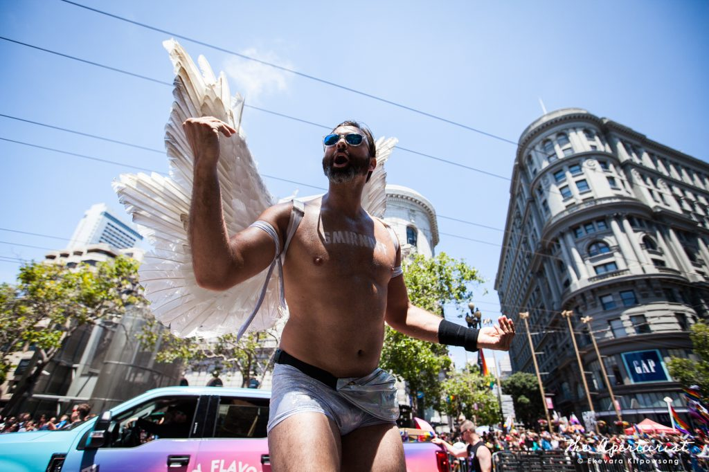 A parade participant from Diageo – Smirnoff wears a costume with feather wings, takes part in the San Francisco Pride Parade on Sunday, June 24, 2018, in San Francisco, Calif. (Photo by Ekevara Kitpowsong/Current SF)