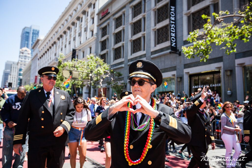 The 26th San Francisco Fire Chief Jeanine Nicholson and the first openly LGBTQ fire chief in San Francisco's history shows a heart sign with hands to the crowd during the 49th annual San Francisco Pride Parade on Market Street in San Francisco on Sunday, June 30, 2019. (Photo by Ekevara Kitpowsong/Current SF)