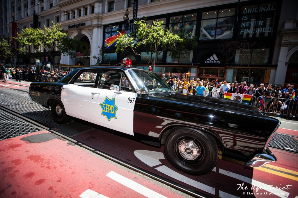 A vintage San Francisco Police Car rolls down Market Street in Downtown San Francisco during the San Francisco Pride Parade on Sunday, June 30, 2019. (Photo by Ekevara Kitpowsong/Current SF)