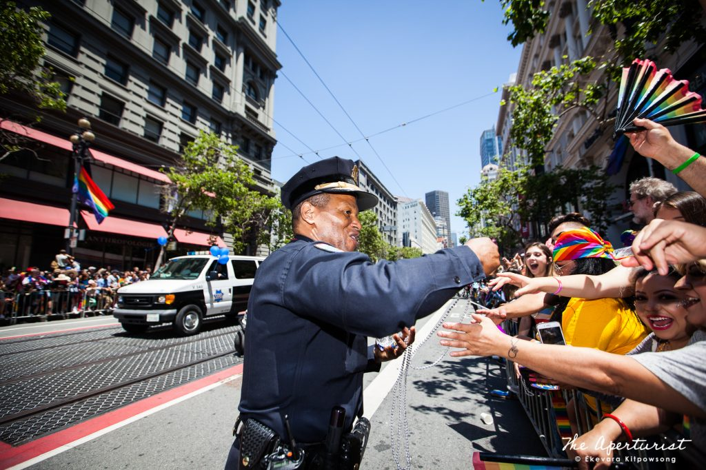 San Francisco Police Chief Bill Scott smiles as he hands out the beaded necklaces to the crowd on Market Street during the San Francisco Pride Parade in San Francisco on Sunday, June 30, 2019. (Photo by Ekevara Kitpowsong/Current SF)