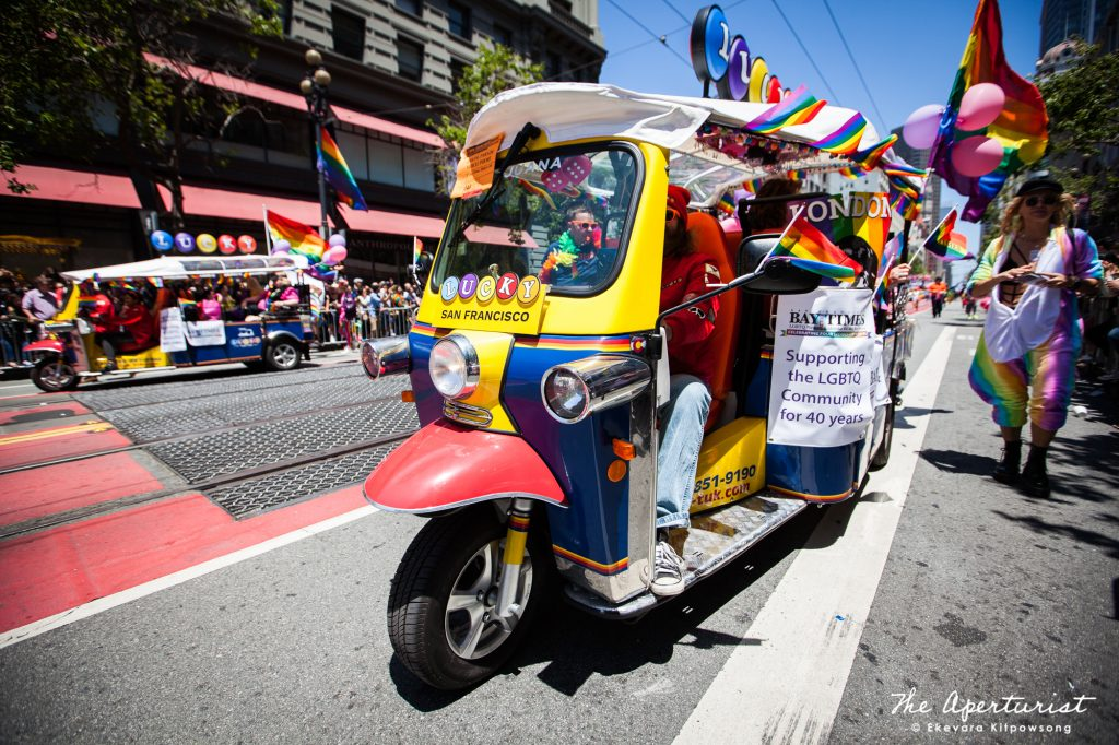 A parade participant from San Francisco Bay Times rides a three-wheeled Tuk Tuk, on Market Street in San Francisco during the San Francisco Pride Parade on Sunday, June 30, 2019. (Photo by Ekevara Kitpowsong/Current SF)