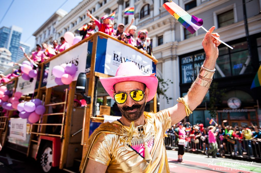 A parade participant wears a golden creative costume waves a rainbow flag during the San Francisco Pride Parade on Market Street in San Francisco on Sunday, June 30, 2019. (Photo by Ekevara Kitpowsong/Current SF)