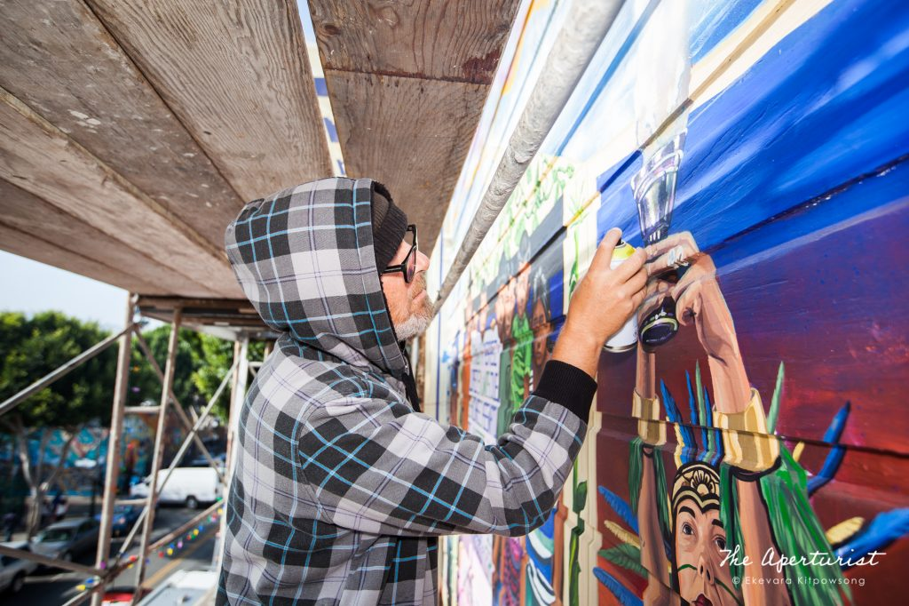 A muralist Pancho Pescador works on The Justice4Amilcar Mural, Alto al Fuego en La Misón, on 24th and Capp streets in the Mission District, San Francisco on Saturday, Nov. 9, 2019. (Photo by Ekevara Kitpowsong/Current SF)