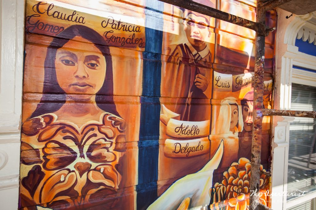The Justice4Amilcar mural, Alto al Fuego en La Misón, at 24th and Capp streets, is in progress, Sunday, Nov. 10, 2019, Mission District, San Francisco. (Photo by Ekevara Kitpowsong/Current SF)