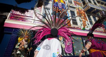 The Danza Xitlalli group performs a blessing ceremony in front of the Justice 4 Amilcar mural on the new offices of the Calle24 Latino Cultural District at24th and Capp streets in the Mission District, San Francisco onSunday, Nov. 17, 2019.(Photo by Ekevara Kitpowsong/Current SF)