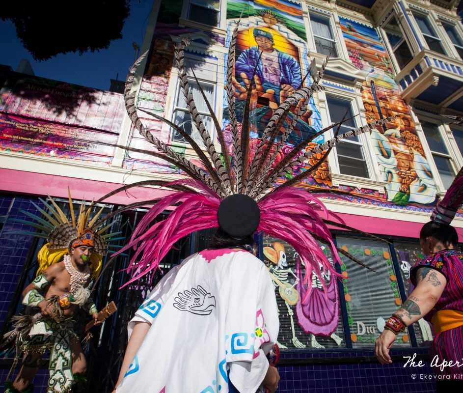 The Danza Xitlalli group performs a blessing ceremony in front of the Justice 4 Amilcar mural on the new offices of the Calle24 Latino Cultural District at 24th and Capp streets in the Mission District, San Francisco on Sunday, Nov. 17, 2019. (Photo by Ekevara Kitpowsong/Current SF)