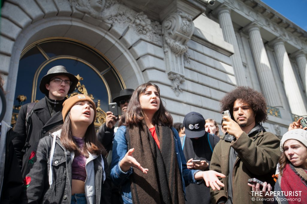 Students speak to the crowds gathered in front of San Francisco City Hall on Wednesday, March 14, 2018. Hundreds of San Francisco Bay Area students walked out of classroom as part of a nationwide school walkout to protest against gun violence on the one-month anniversary of the high school shooting that a gunman killed 17 people at Marjory Stoneman Douglas High School in Parkland, Florida. (Photo by Ekevara Kitpowsong)