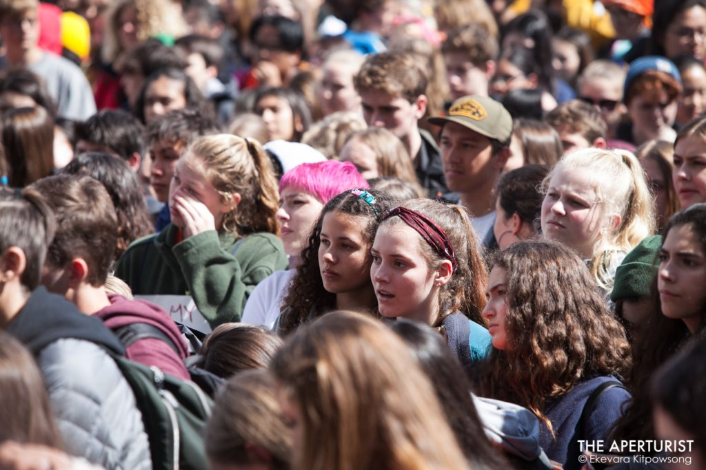 Students gather in front of San Francisco City Hall as part of a nationwide school walkout to protest against gun violence on the one-month anniversary of the high school shooting that a gunman killed 17 people at Marjory Stoneman Douglas High School in Parkland, Florida, Wednesday, March 14, 2018 in San Francisco, Calif. (Photo by Ekevara Kitpowsong)