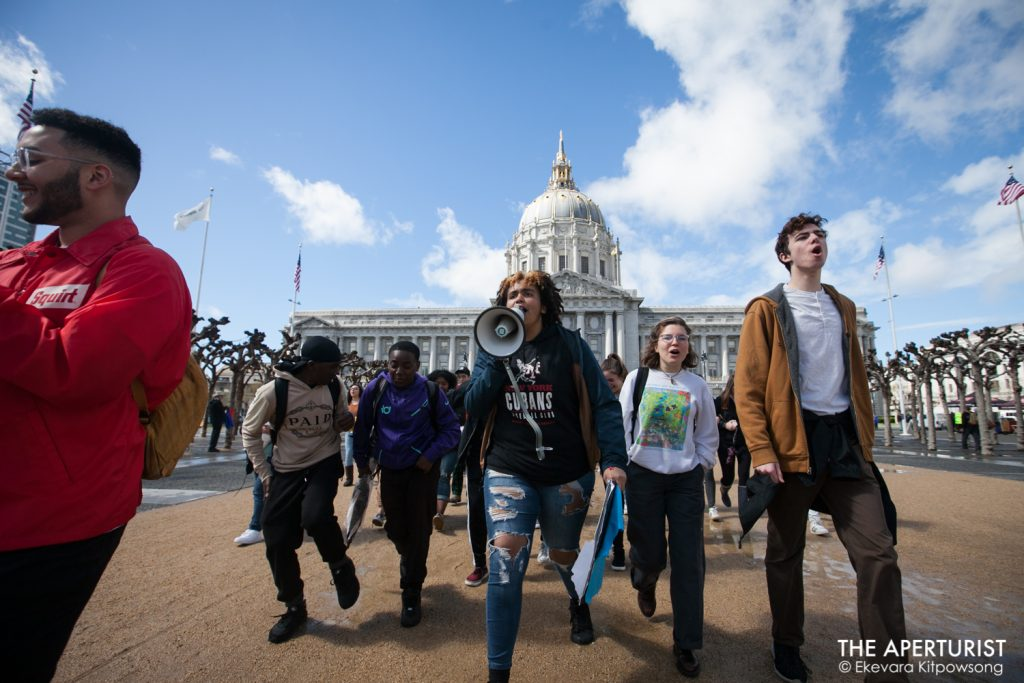 Students march from San Francisco City Hall to Embarcadero as part of a nationwide school walkout to protest against gun violence on the one-month anniversary of the Parkland school shooting in Florida that a gunman killed 17 people, Wednesday, March 14, 2018. (Photo by Ekevara Kitpowsong)