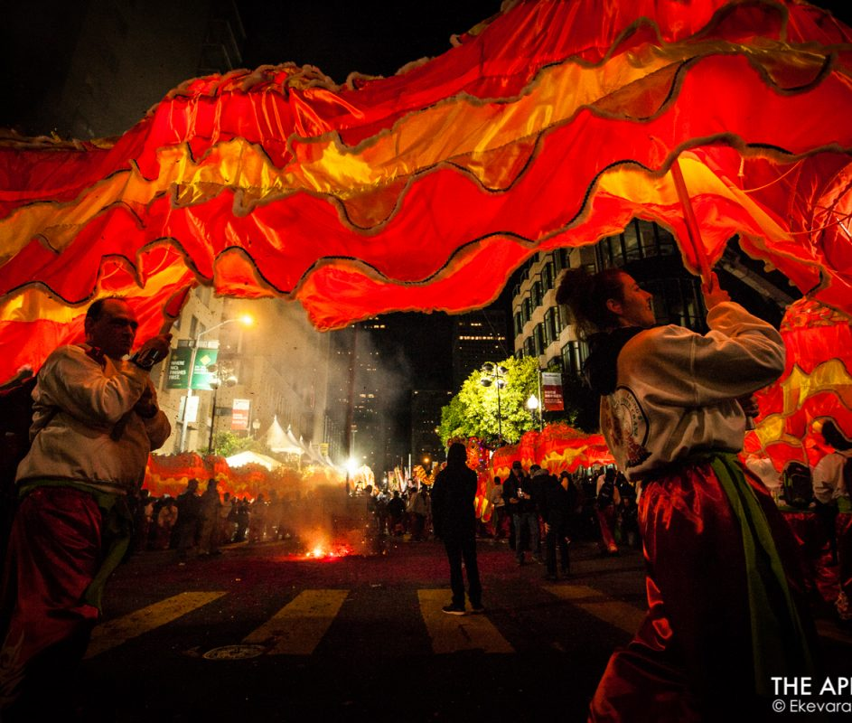 """A 288-foot-long Golden Dragon """"Gum Lung"""" performs in a circle around the exploding fireworks during the San Francisco's Chinese New Year Parade on Saturday, Feb. 23, 2019. (Photo by Ekevara Kitpowsong/Current SF)"""