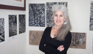 """A muralist Juana Alicia poses for a portrait with her illustrations that are going to be displayed in the art exhibit """"The X'tabay, a Contemporary Vision,"""" at her Berkeley studio on Monday, April 29, 2019. (Photo by Ekevara Kitpowsong/ Current SF)"""